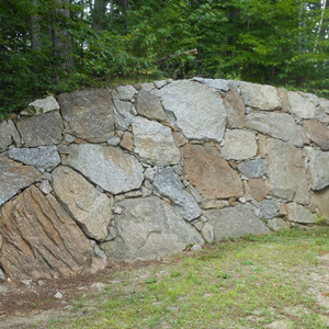 Rock Wall Design create a cozy outdoor space with a curved rock wall Rock Boulder Stone Retaining Walls